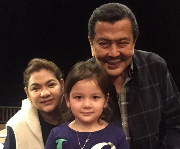 Ellie poses with Lolo Erap in a photo