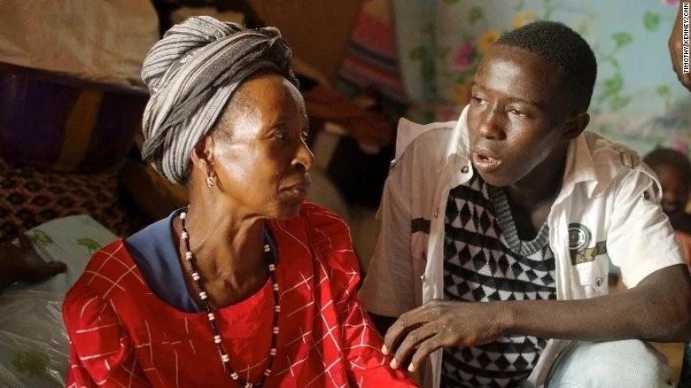 Hawa Marah and her grandson. She lost three of her five children. Photo: CNN