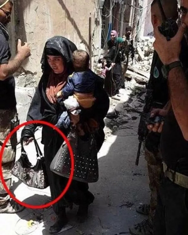 The woman and her baby, with the handbag said to have contained the detonator. Photo: Mirror