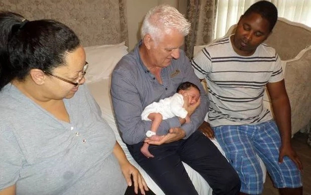 ENDEARING COINCIDENCE! This same midwife delivered both father and son, 33 years apart