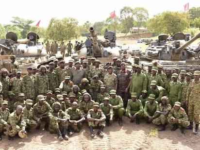 Museveni promises pay rise for soldiers after bloodless coup in Zimbabwe