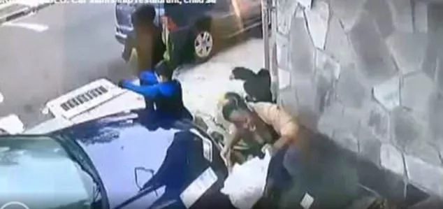 Brave woman shields boy from impact of car that rammed into wall