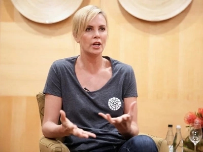 Award-winning actress Charlize Theron reflects on growing up when Aids was an unknown 'monster'