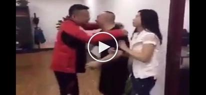Harap-harapang iniiputan sa ulo! Man caught kissing friend's wife in viral clip