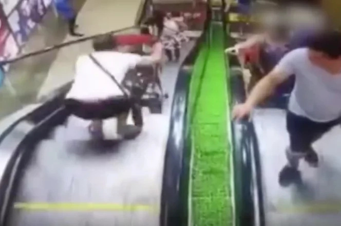 Baby falls down on escalator as mother loses control of stroller