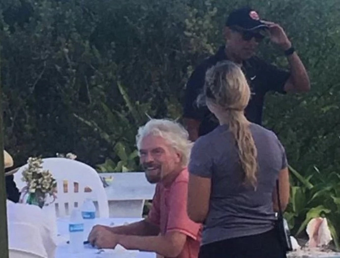 Luxury vacation: OBAMAS spotted relaxing with BILLIONAIRE on his private island (photos)