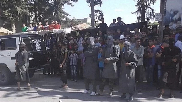 "ISIS thugs cut off the hand of a ""thief"" in public"