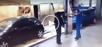 Daring car wash employee forces hold-upper to wash cars after taking away his gun