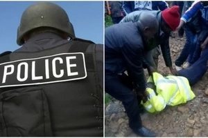 Dramatic moment as policeman is carried like a sack after he was caught taking bribes(photos)