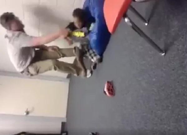 teacher-tosses-student