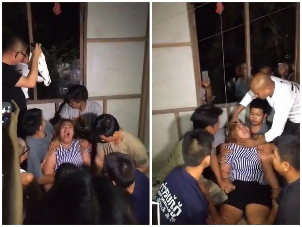 Demon-possessed woman screams in agony as men exorcise spirits inside her with HAMMER (photos)