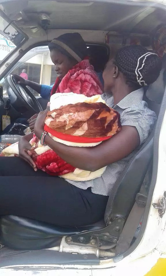 Young girl delivers inside a matatu on her way to visit her mother