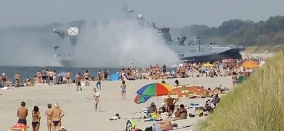 Amazing Video Of Military Hovercraft Pushing Across Beach Full Of People!