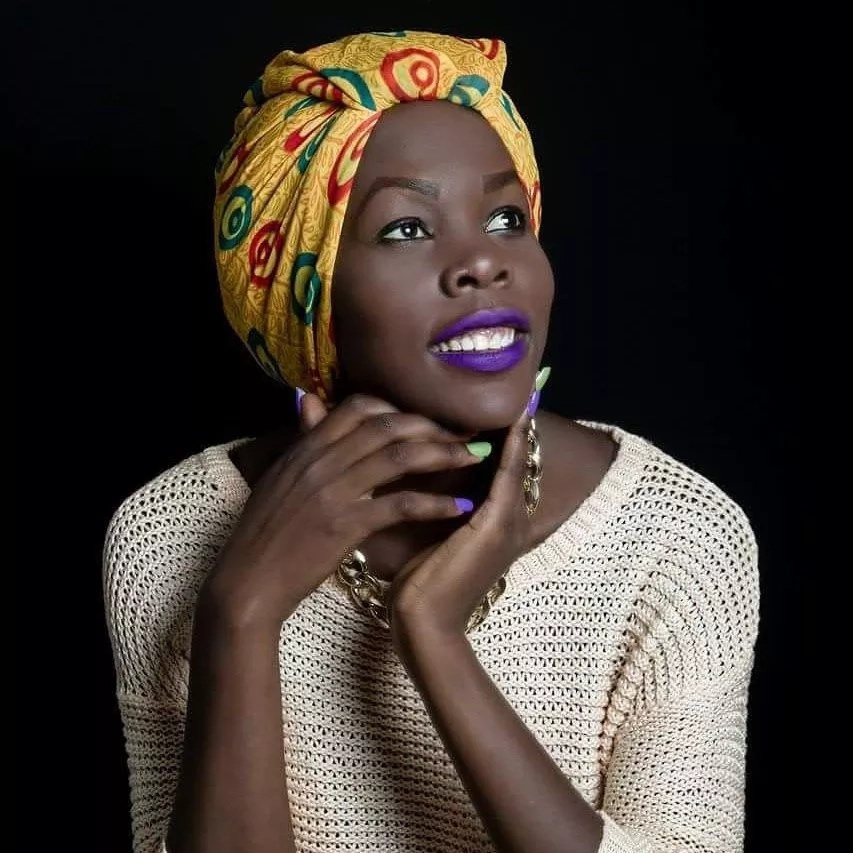 Watch how this lady uses head wraps with beautiful results - and good business