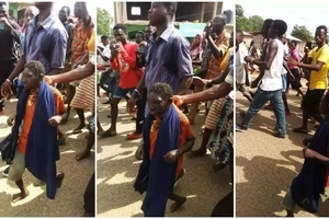 "Locals in African town claim to have found a ""dwarf god"" and parade him on the streets (photos, video)"