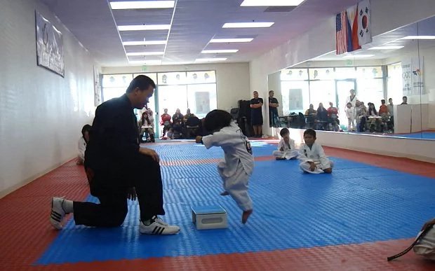 Adorable kid takes his Taekwondo test