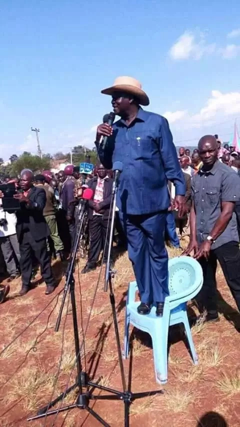 Raila addresses a crowd on top of a plastic chair- risks a bad fall