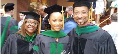 Because of them, I am! Woman thanks her parents after graduating from the same college they did
