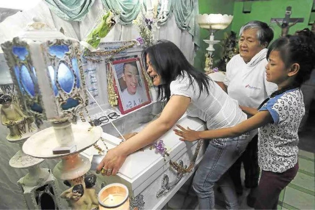 OFW comes home to bury son, a victim of the drug war