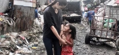 Catriona Gray taps supporters' help to 'keep torches burning' for poor children