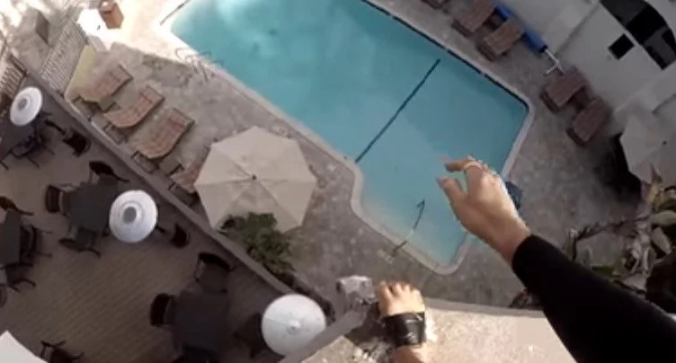Daredevil Makes Death-Defying Jump Into Swimming Pool