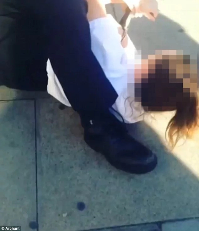 Police officer is caught on camera dragging 13-year-old girl by her hair