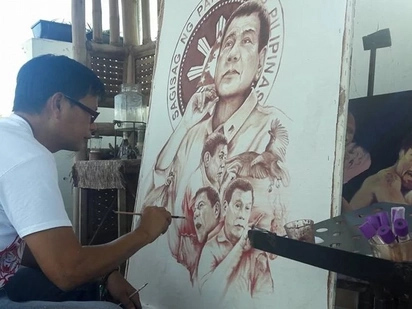 Buwis buhay! Local artist paints President Duterte using his own blood and sweat