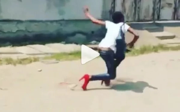 Beautiful girl trips on her high-heels and falls into an open sewer (photos)