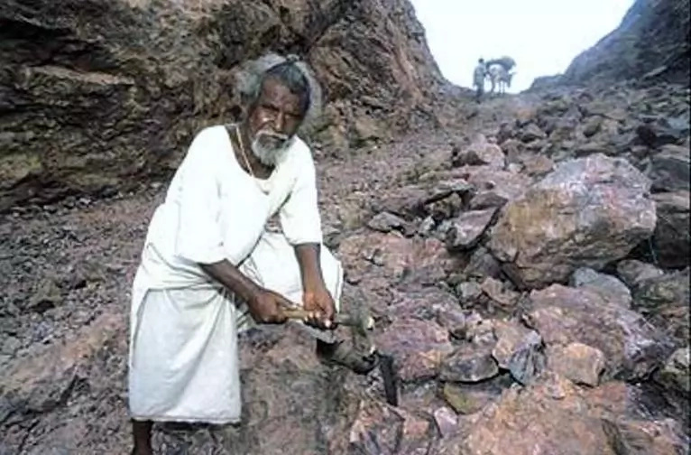 After his wife died from lack of medical care, husband spent 22 years carving way through mountain so his people could reach a doctor In Time