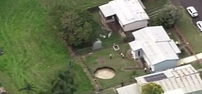 An elderly couple woke up to find this giant sinkhole in their yard!
