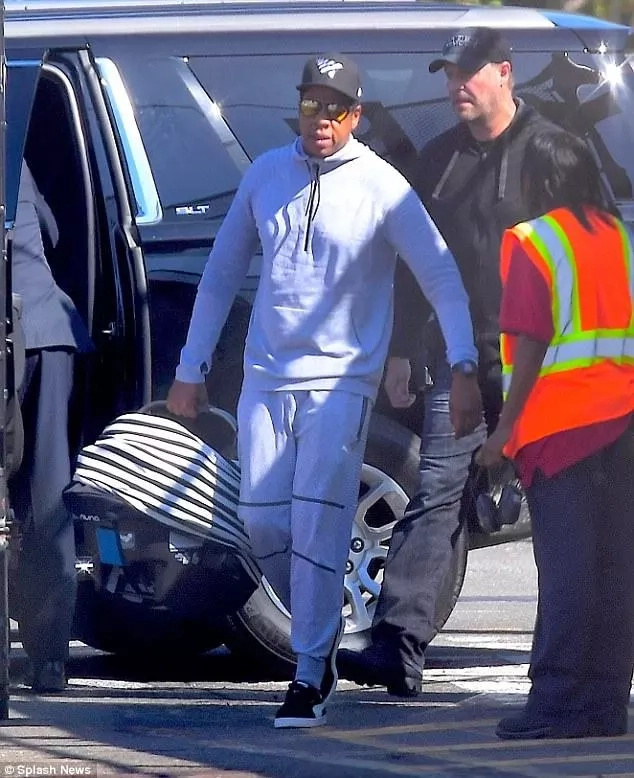 Jay Z seen carrying their twins. Photo: Splash News