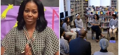 Michelle Obama makes SURPRISE visit to school to mark International Women's Day (photos)