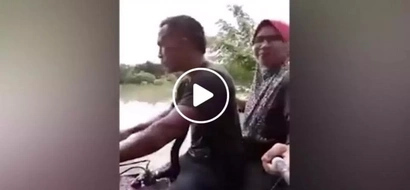 That must have been so dangerous! Clever couple uses motorcycle to cross a flooded road