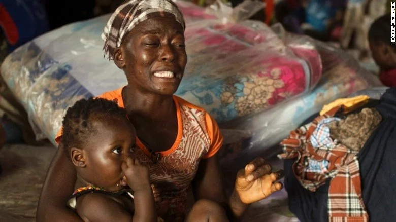 Wuiatu Kondeh with her daughter Antoinette. She lost her husband, uncle, sister, and her sister's children. Photo: CNN