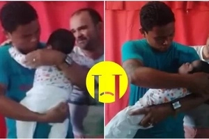 This father takes out his tiny son from coffin and doesn't want to put him back (photo, video)