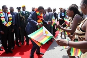 See president hitting DANCE floor as he is welcomed at airport (photos)