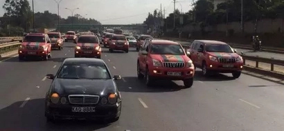Uhuru's Jubilee Party convoy of luxury vehicles interrupts traffic in Nairobi (photos)