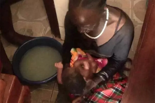 A rescuer bathes the baby