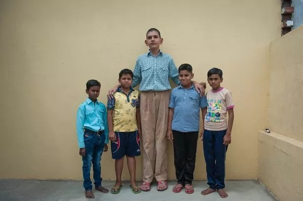 He aims for the world's tallest eight-year-old record. Photo: Barcroft