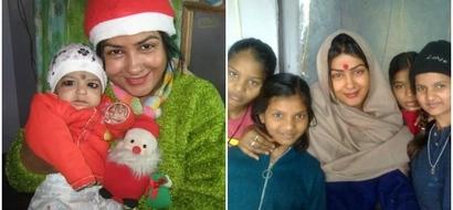 Meet woman, 42, who left high-paying fashion designer job to adopt 98 poor children (photos)