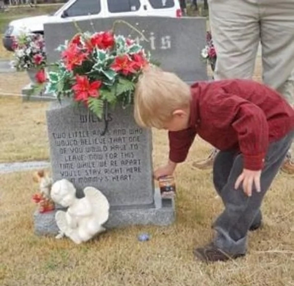 This cute boy after the 1st day at school went to the graveyard