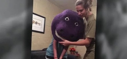 WATCH: Friends film teenager with Barney mask stuck on head