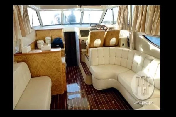 WOW Cruiser II Interiors: custom-made white couches and wooden floor, photo by PEP.