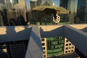 Crazy Man Sits On The Top Of A Skyscraper And Spins Around In Vertigo Inducing Video