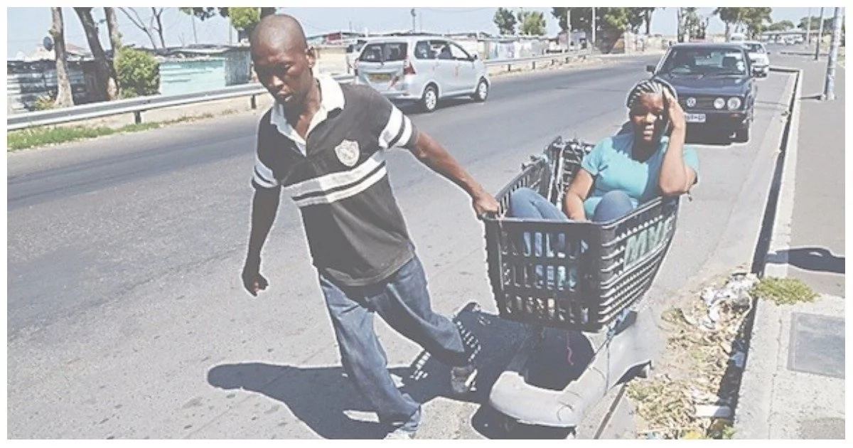 South African man moves his girlfriend around in a trolley