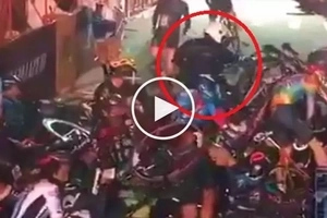 Motorcycle rider causes massive pile-up during intense bicycle race