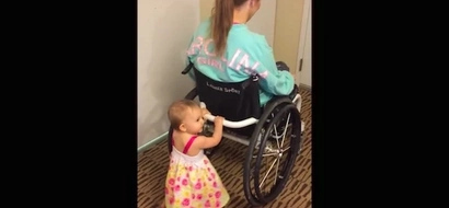Disabled mom uses her wheelchair to teach her baby how to walk