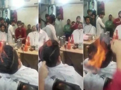 Hot! See hairdresser setting his client's hair on FIRE (photos, video)