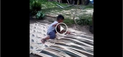 Young boy weaving bamboo sawali.. Child Labor or Industrious Boy?