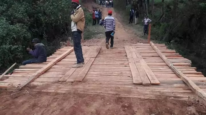 CHINEKE!Jubilee governor aspirant lands in a chopper to launch a WOODEN bridge(photos)